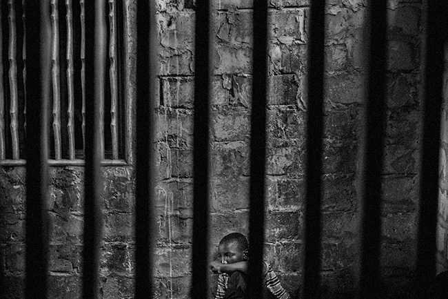 Talibes, Modern-day Slaves - Mário Cruz - Abdoulaye, 15, is a talibe imprisoned in a room with security bars to keep him from running away.